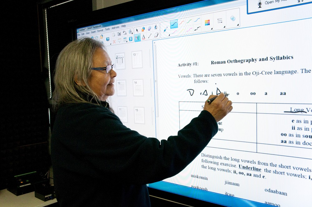 A WDEC Teacher demonstrates Native Languages using a SMART Board
