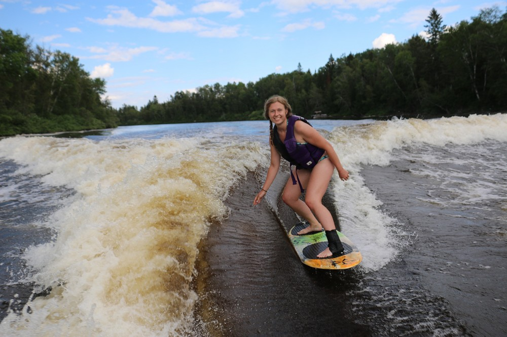 Maia wake-surfing on a lake in Timmins